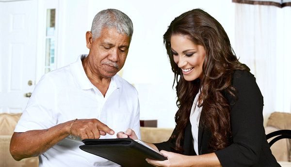 elderly man and woman looking at the document