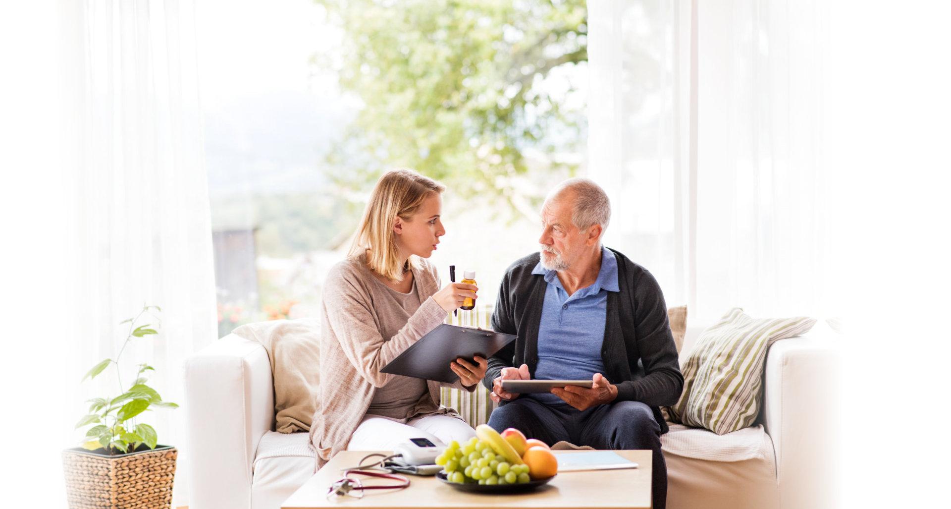 man talking to elderly man